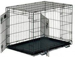 An empty wire dog crate with front and side doors open