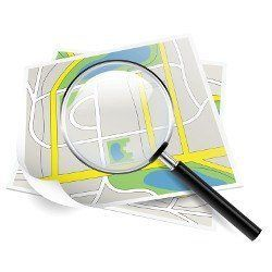 An animated magnifying glass held over a map