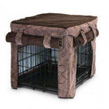 A brown dog crate cover with rolled up curtains from Snoozer